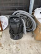 AN OASE VACUUM CLEANER
