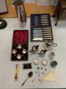 AN ASSORTMENT OF SILVER PLATE ITEMS: A BOXED CONDIMENT SET, JUGS, A PAIR OF SALTS, FISH KNIVES AND