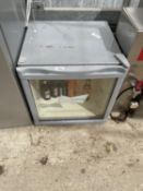 A SMALL 'BUDWEISER' BOTTLE FRIDGE BELIEVED WORKING BUT NO WARRANTY