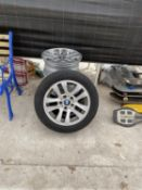 A SET OF FOUR BMW RIMS TWO WITH TYRES