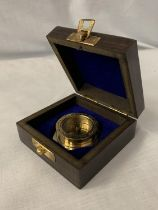 A BOXED 'HENRY HUGHES' BRASS COMPASS