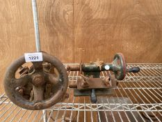 A VINTAGE LATHE HANDLE AND PULLEY SYSTEM