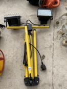 A WORK LIGHT WITH TRIPOD STAND AND TWO SPOTLIGHTS
