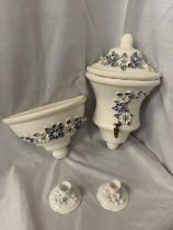 A PAIR OF CERAMIC WALL MOUNTED WATER VESSEL AND BOWLWITH DECORATIVE BLUE AND WHITE FLOWERS IN