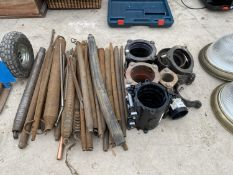 A LARGE QUANTITY OF PIPE BENDING SPRINGS AND AN ASSORTMENT OF PIPE COUPLINGS