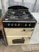 A CREAM AND BLACK LEISURE FREE STANDING COOKER AND HOB BELIEVED WORKING BUT NO WARRANTY