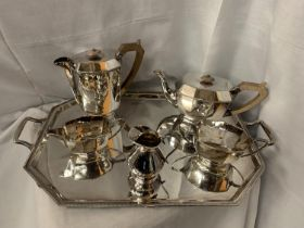 A LARGE SILVERPLATE TRAY WITH TWO SILVERPLATE TEA POTS, MILK AND CREAMER JUGS AND SUGAR BOWL