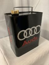 A BLACK METAL 'AUDI' FUEL CAN WITH A BRASS LID