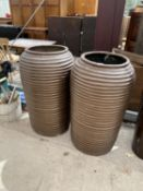 A PAIR OF DECORATIVE BROWN FIBRE GLASS BEE HIVE STYLE PLANTERS (H:90CM)