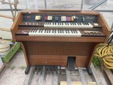 A HOWARD 245 ELECTRIC ORGAN BELIEVED IN WORKING ORDER BUT NO WARRANTY