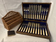 A MAHOGANY AND BRASS INLAY CANTEEN OF CUTLERY WITH TWELVE SETS OF FISH KNIVES AND FORKS AND A LETTER