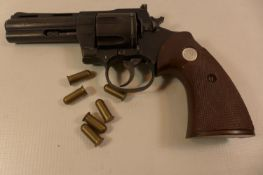 A REPLICA NON FIRING SMITH AND WESSON PYTHON 357 MAGNUM REVOLVER WITH A 10CM BARREL AND HAMMER A/F