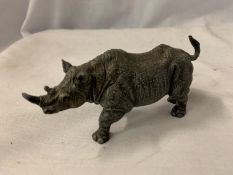 A COLD PAINTED BRONZE RHINO