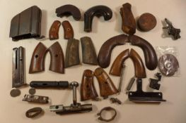 A COLLECTION OF GUN PARTS, TO INCLUDE SETS OF WOODEN GRIPS, MAGAZINES,SPRINGS ETC