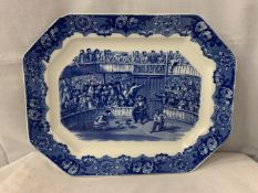 A LARGE BLUE AND WHITE MEAT PLATTER DEPICTING COCK FIGHTING AND STAMPED SPANISH FESTIVITIES 1798
