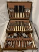 A FORTY EIGHT PIECE CANTEEN OF CUTLERY IN AN OAK PRESENTATION CASE