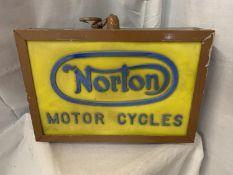 AN ILLUMINATED 'NORTON MOTOR CYCLES' SIGN
