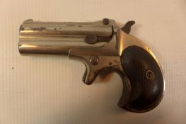 A REMINGTON 41 CALIBRE RIMFIRE OVER AND UNDER DERRINGER, WITH A 7.5CM BARREL MARKED REMINGTON ARMS