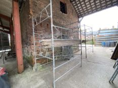13 SECTIONS SCAFFOLD TOWER WITH 4 JACK LEGS, 2' STABILIZERS AND TIMBER PLATFORM TO REACH 30'