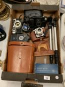 A BOX CONTAINING CAMERAS, A CANON, A YASHICA GSN AND AN AGFA ISOLA AND A PAIR OF NIPOLE BINOCULARS
