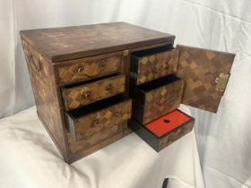 A MARQUETRY CABINET WITH FOUR DRAWERS, TWO INNER DRAWERS, DECORATIVE HINGES AND SIDE HANDLES (NO