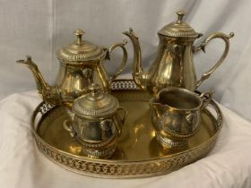 A FOUR PIECE SILVER PLATED TEA SET ON A TRAY