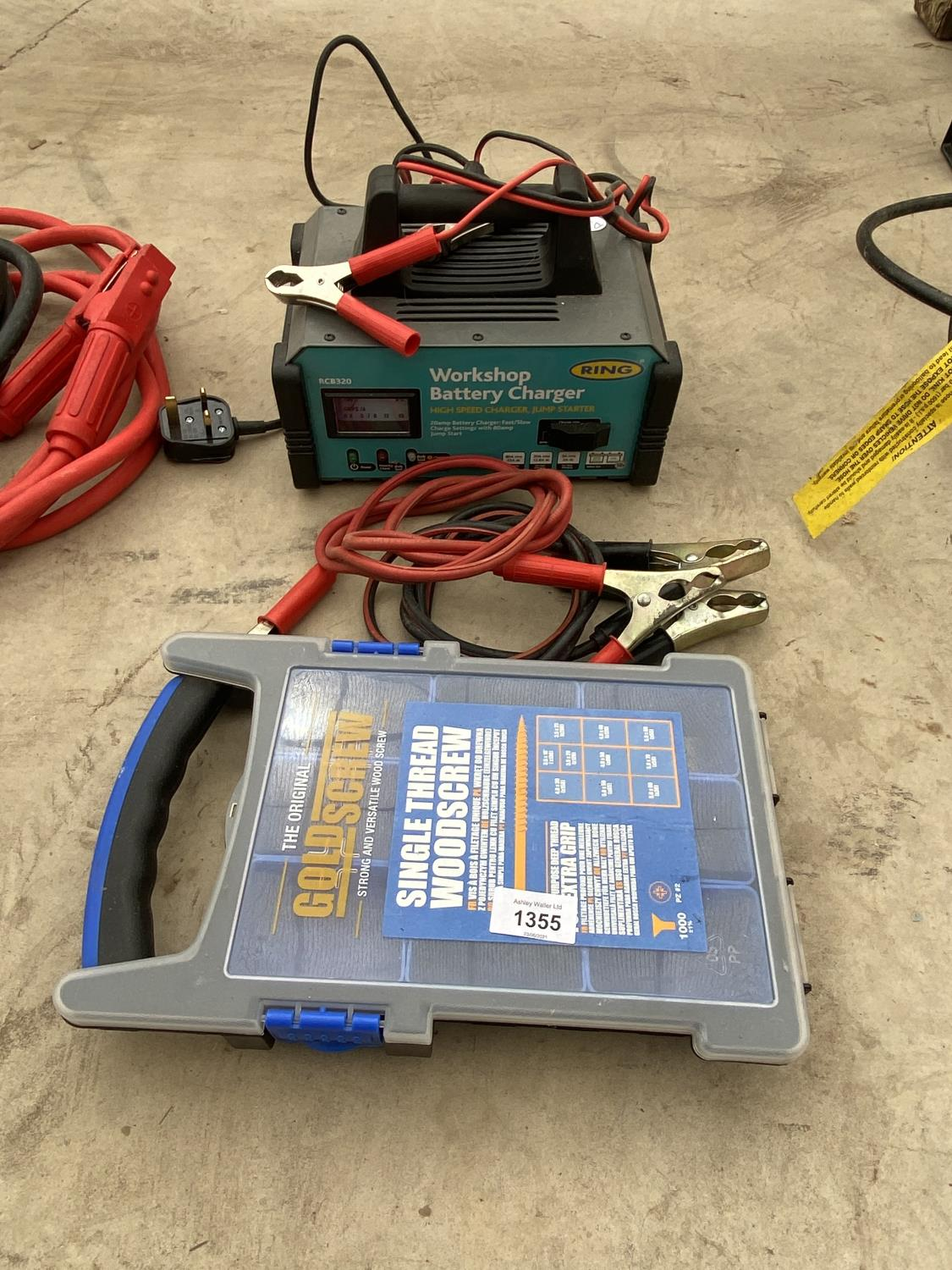 A BATTERY CHARGER, EXTENSION LEADS AND A SCREW BOX
