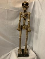 A TALL WOODEN CARVED SKELETON FIGURINE H:114CM