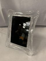 A WATERFORD CRYSTAL PHOTOGRAPH FRAME FOR A 10CM X 15CM PHOTO