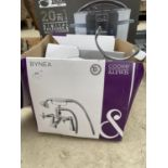 A SHOWER MIXER TAP AND A PRESSURE KING 20 IN 1 MULTI COOKER