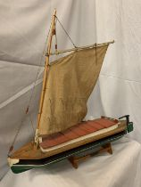 A HANDMADE NORFOLK BROADS WHERRY BOAT ON A STAND