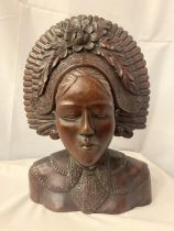 A HEAVILY CARVED BUST OF A BALI LADY H:46CM