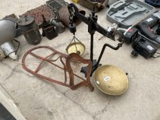 A SET OF BALANCE SCALES AND A VINTAGE SADDLE RACK