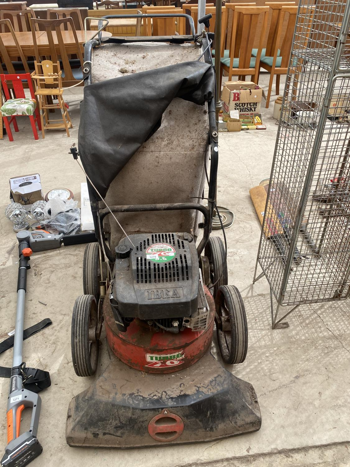 AN IBEA GARDEN HOOVER WITH TURBO 70 PETROL ENIGINE
