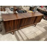 A RETRO HARDWOOD SIDEBOARD WITH FOUR SLIDING DOORS