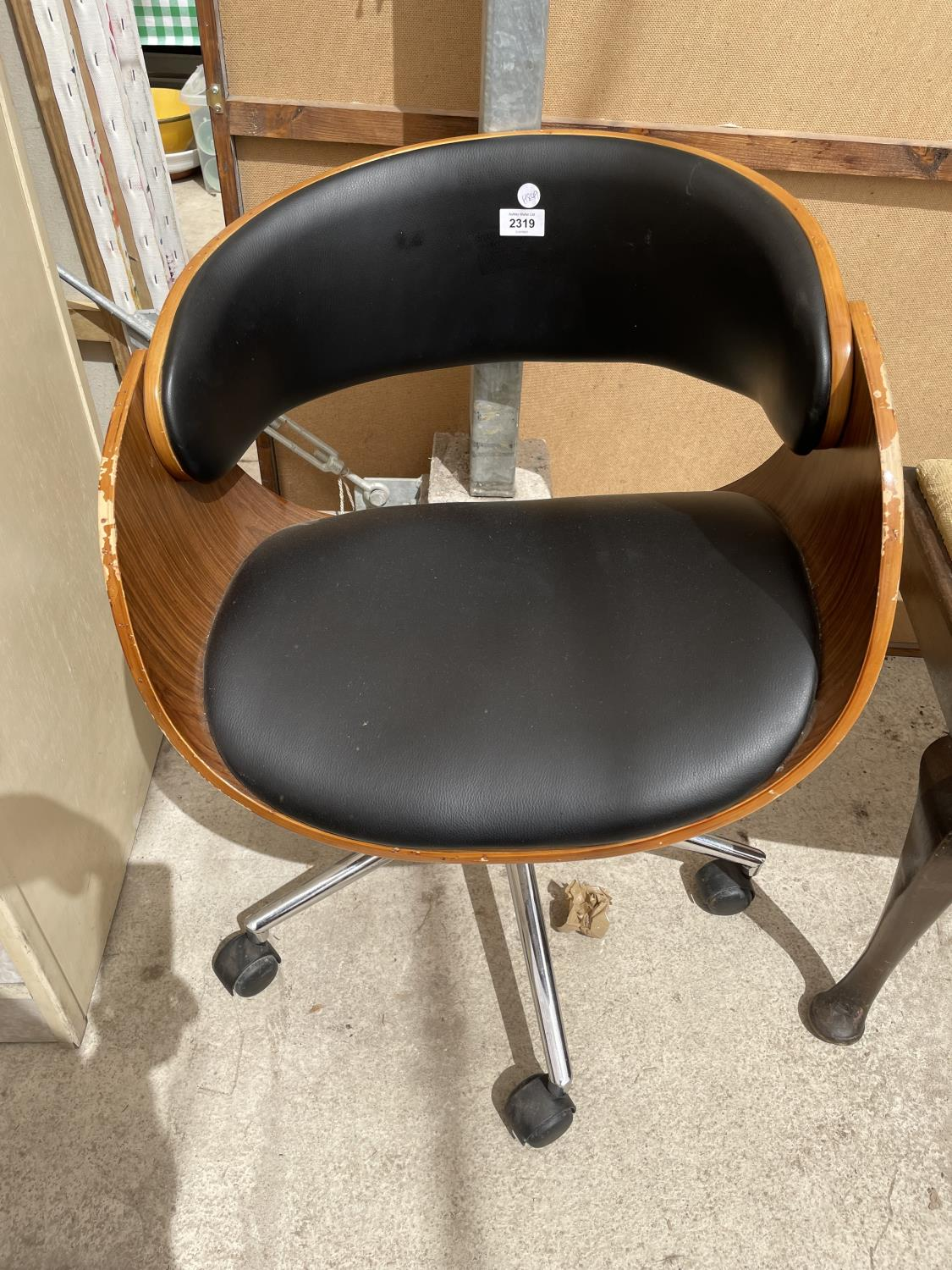 AN EAMES STYLE OFFICE SWIVEL CHAIR