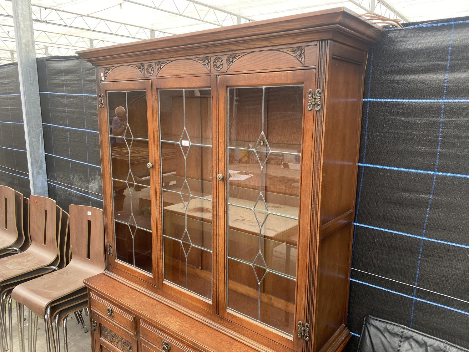 AN OAK OLD CHARM GLAZED AND LEADED CABINET ON BASE ENCLOSING THREE DRAWERS AND THREE CUPBOARDS, 52. - Image 3 of 5