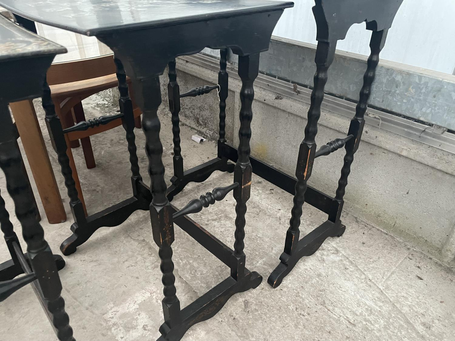 A NEST OF FOUR EBONISED AND PAPIER MACHE TABLES, THREE TABLES BEARING HUNTING IMAGE AND ONE WITH - Image 9 of 9