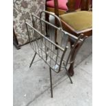 AN EDWARDIAN BRASS TWO DIVISION MAGAZINE/PAPER RACK