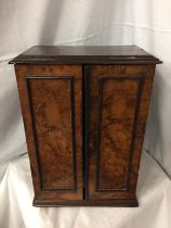 A WALNUT MINATURE CABINET TO INCORPORATE SEVEN DRAWERS 44CM HIGH POSSIBLY A WATCH MAKERS CABINET