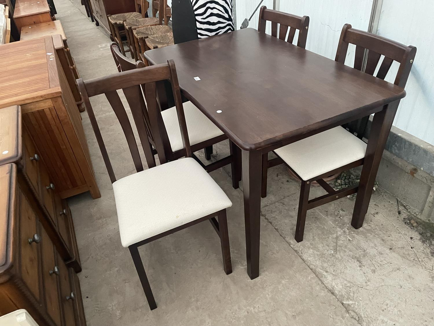 A MODERN DINING TABLE AND FOUR CHAIRS
