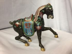 A CHINESE BRONZE CLOISONNE ENAMEL AND GILT HORSE