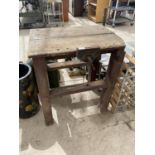 A SMALL VINTAGE WORK BENCH WITH SMALL PARAMO BENCH VICE