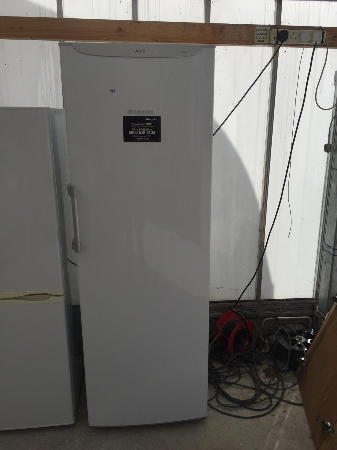 A WHITE HOTPOINT UPRIGHT FRIDGE BELIEVED IN WORKING ORDER BUT NO WARRANTY