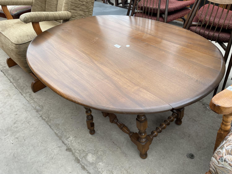 AN ERCOL TWIN-LEAF COFFEE TABLE