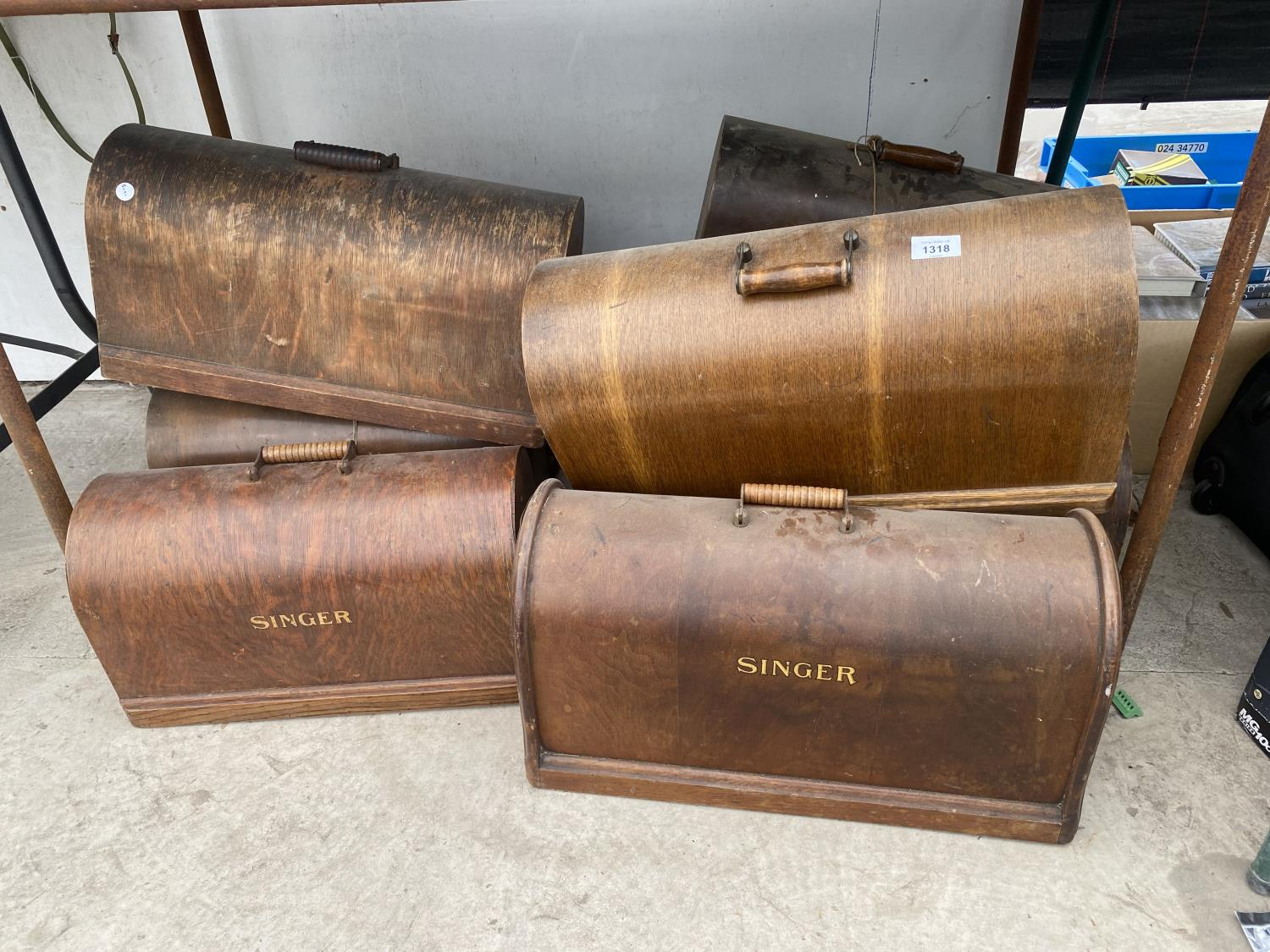 A LARGE QUANTITY OF SINGER SEWING MACHINE CASES