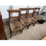 FOUR VICTORIAN BEECH FRAMED CHAPEL CHAIRS WITH RUSH SEATS