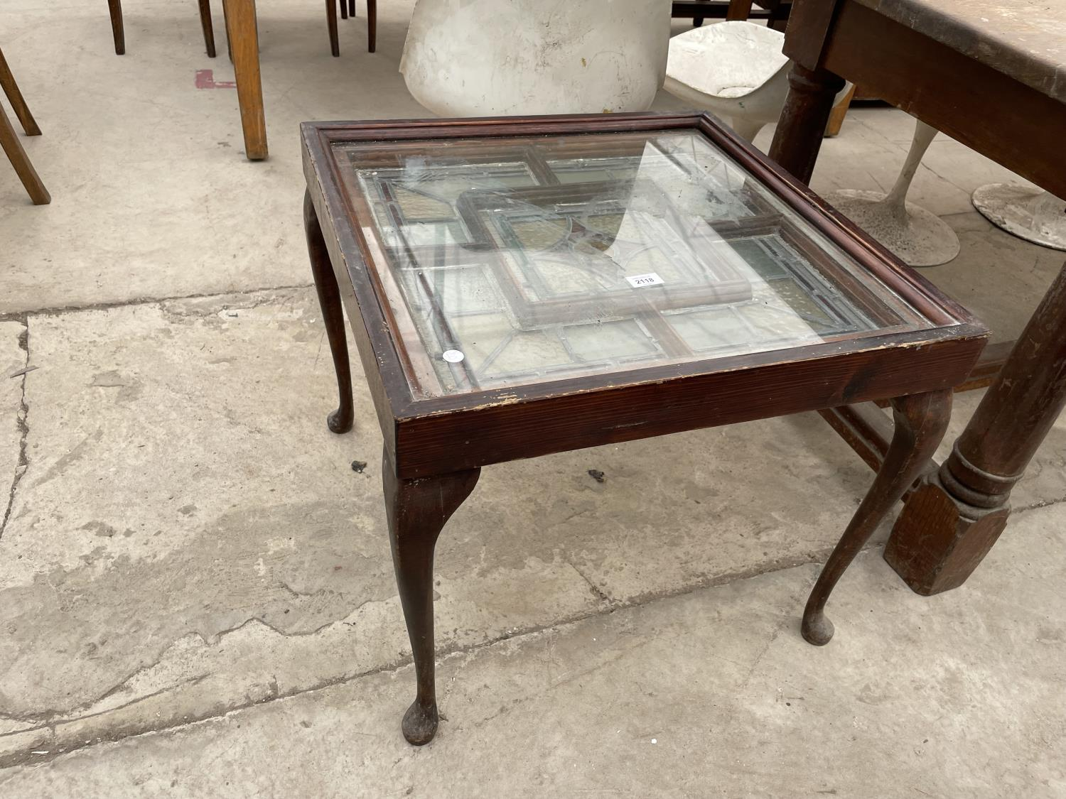 """AN UNUSUAL COFFEE TABLE FORMED FROM STAINED GLASS WINDOW, ON CABRIOLE LEGS, 24"""" SQUARE"""