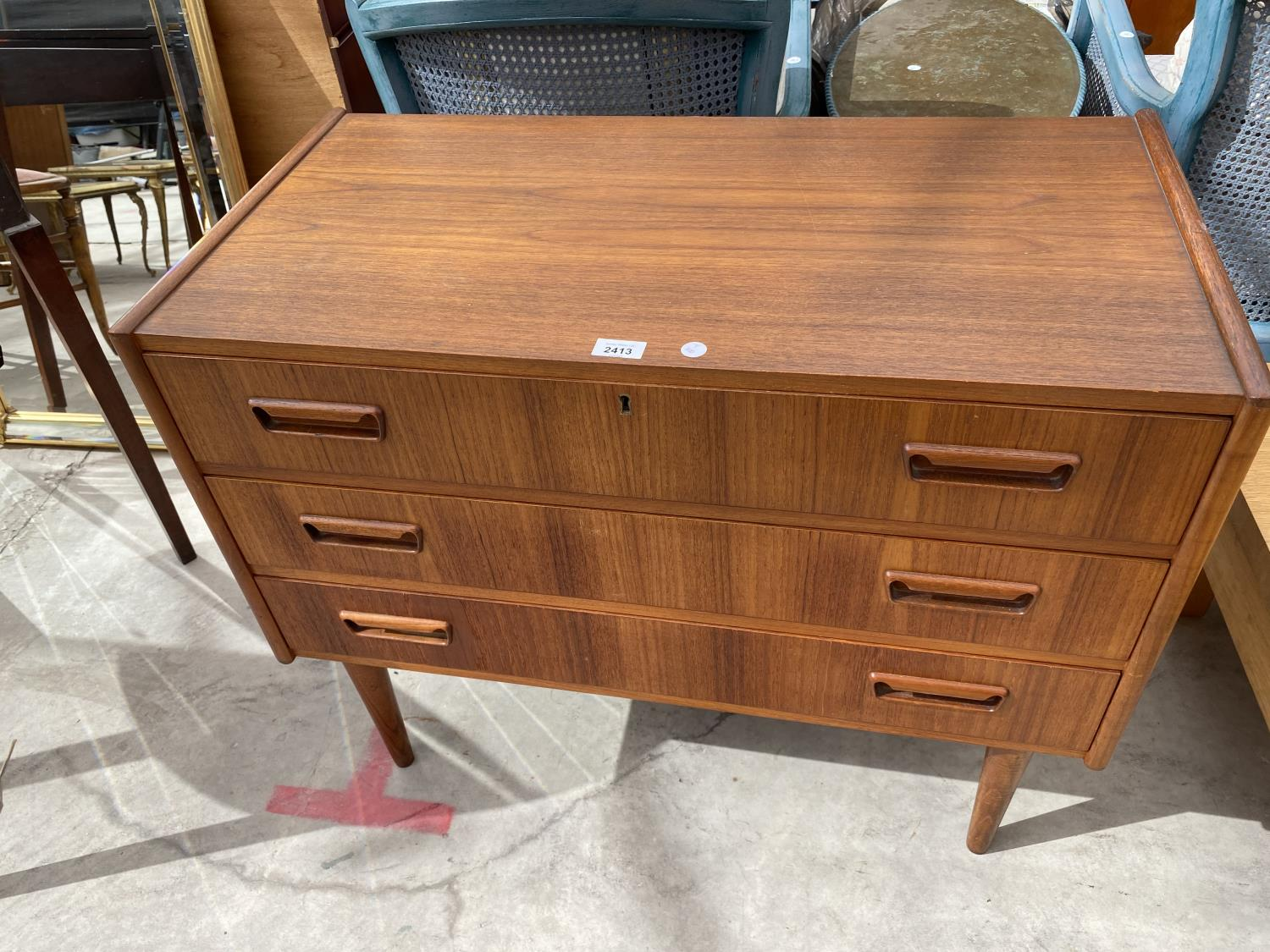 """A RETRO TEAK CHEST OF THREE DRAWERS BEARING STAMP 'MADE IN DENMARK, DESIGNED BY TIBERGAARD', 33.5"""""""