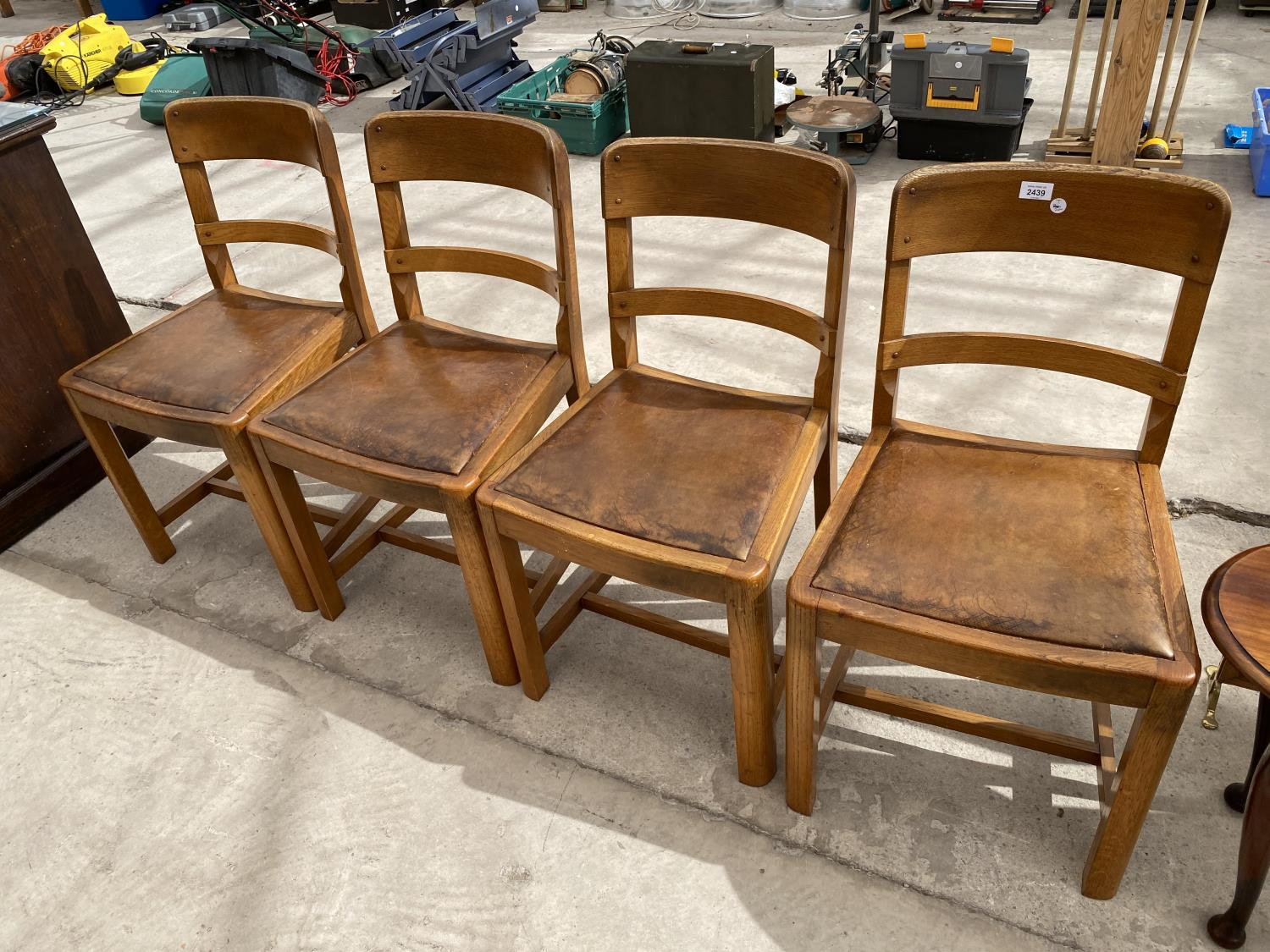 A SET OF MID 20TH CENTURY OAK DINING CHAIRS